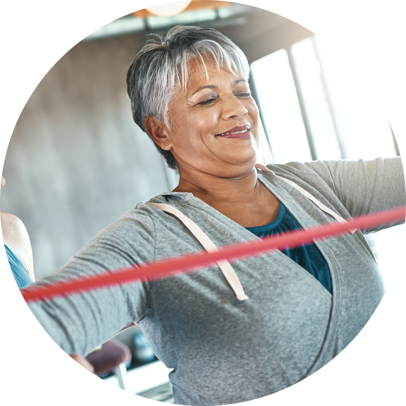 smiling african american older women working out with bands