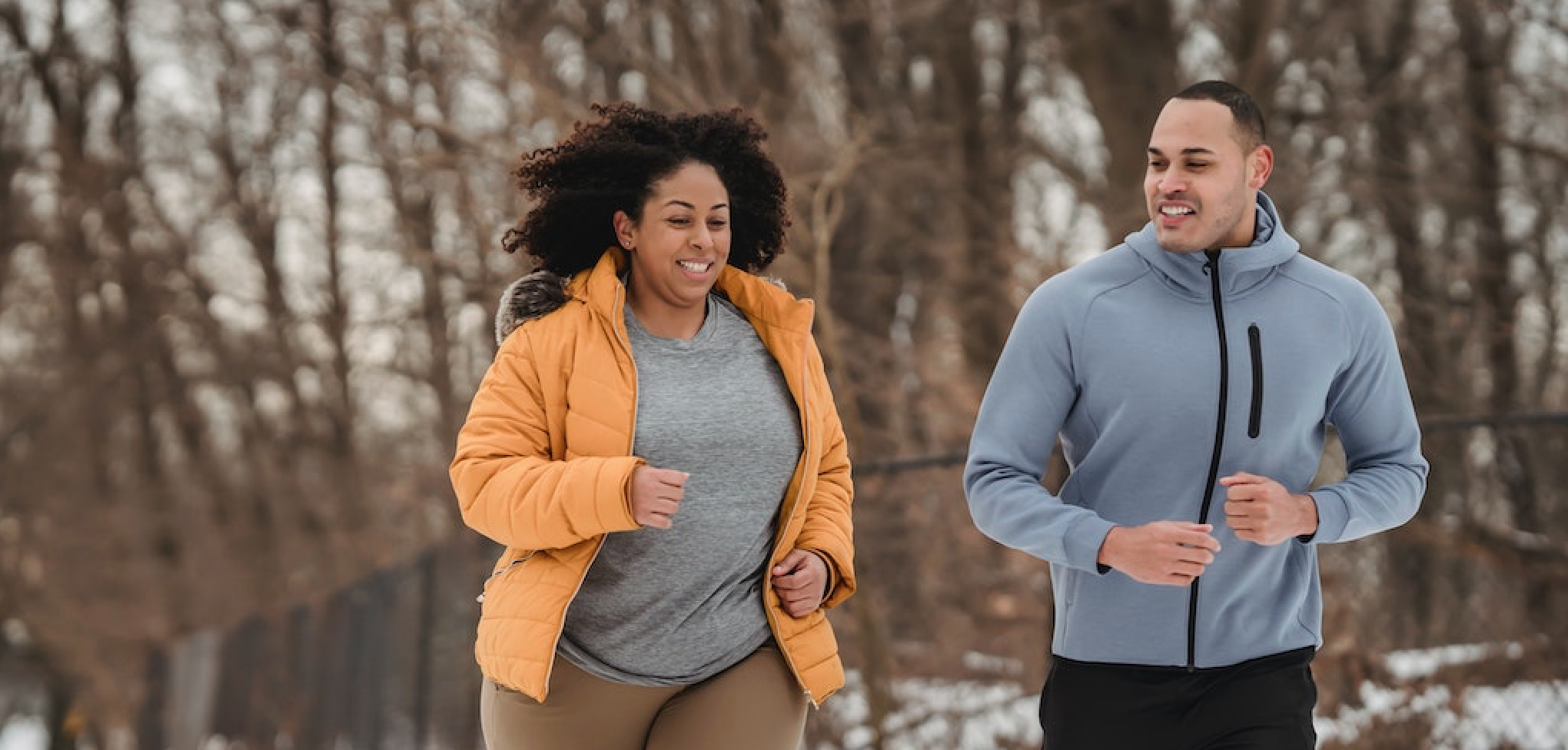 african-american-couple-running-in-winter-cropped