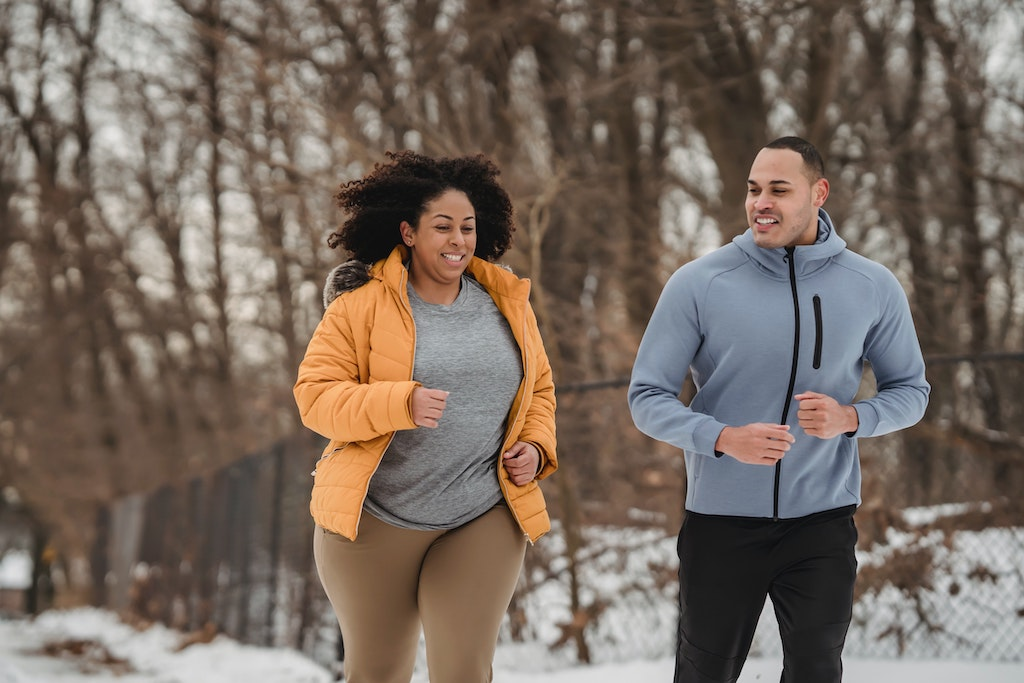 african american couple running in winter